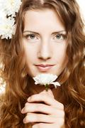 woman face with white flowers - stock photo