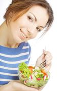 Girl eating healthy food Stock Photos