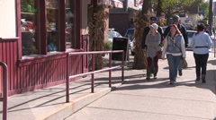 Tourists enjoying a fine fall day in St Jacobs Ontario Stock Footage