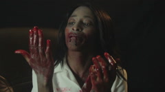 Stock Video Footage of Vampire Girl in Ecstasy Plays with Blood on Face Hands Body