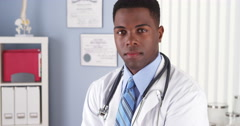 Confident African American doctor in clinic - stock footage