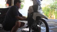 Mechanic repair motorcycle, Asia Stock Footage