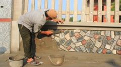 Worker install stone wall surface with cement,Asia Stock Footage