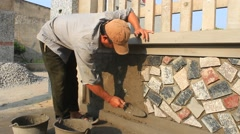 Worker install stone wall surface with cement, Asia Stock Footage