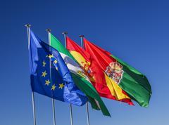spain ec portugal flags granada andalusia spain - stock photo