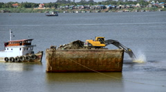 Excavator on Barge Fills Dirt into the River in Cambodia Stock Footage