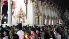 Religious ceremony in Buddhist temple at Asalha Puja Day Stock Footage