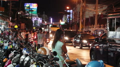 Traffic on street of Pattaya city in night Stock Footage