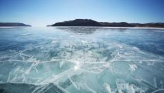 Drive the car across the frozen Lake Baikal, a long video sequence + sound - stock footage