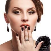 beautiful woman with perfect skin and black nails - stock photo