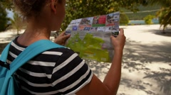 Lost Woman on the Beach Holding a Map. Stock Footage