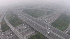 Aerial shot of vehicles driving on an overpass amid the heavy haze and smog Stock Footage