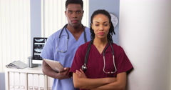 Team of Black medical specialists standing together in hospital - stock footage