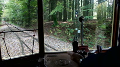 A ride with the trolley car through a forest Stock Footage