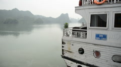 Tourist Boat Slowly Passes By  - Ha Long Bay Vietnam Stock Footage