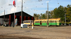 A green cable car in front of a tram depot Stock Footage
