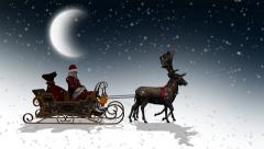 Santa Claus with sleigh and reindeer passes by Stock Footage