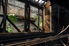 Old trains at abandoned train depot - stock photo