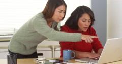 Multi-ethnic businesswomen working together to meet deadline - stock footage