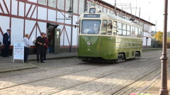 Trolley car on the tracks - leaving the depot area - stock footage