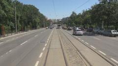 Steady shot inside tram streetcar railway downtown commuting vehicle in big city Stock Footage
