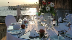 Romantic Table Setting on Pier at Sunse Stock Footage