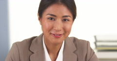 Japanese businesswoman smiling at camera - stock footage