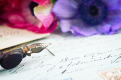 quill pen and antique letters with flowers - stock photo