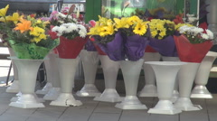 Flowershop flower shop view, pots outdoor waiting customers nice color bouquets  Stock Footage