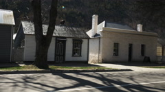 Arrowtown cottages pan Stock Footage