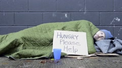 Homeless man begs for change Stock Footage