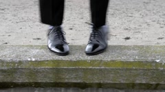 Business man's feet dance in celebration Stock Footage