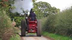 Vintage Steam Traction Engine Driving on Old Country Lane Stock Footage