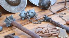 Stock Photo of mallet and other medieval weapons during the reenactment