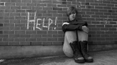 Sad teen girl asks for help - stock footage