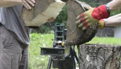 Electric Wood splitter splitting wood Stock Footage