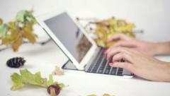 Close up on woman's hands typing on her laptop in bright studio Stock Footage