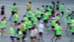 People running marathon on city street Stock Footage