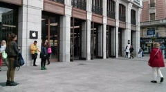 Time lapse of people entering and exiting the new Apple Store in Madrid - stock footage