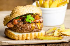 beef burger with bacon, cheddar, homemade fries - stock photo