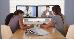 Professional team of diverse business colleagues having a video conference Stock Footage