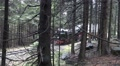 Classic steam locomotive pulls wagons in mountain forest HD Footage