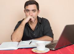 Adult education - hispanic man studying at home Stock Photos