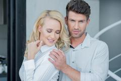 Close Up Middle Age Partners in White Long Sleeves Stock Photos
