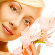 Fresh face with gladiolus flowers in her hands Stock Photos