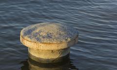mooring bollard on water - stock photo