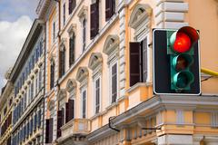 traffic lights at the crossroads of the city is lit red - stock photo