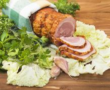 baked boiled pork with greenery - stock photo