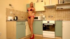 Sexy tall long legs blonde lingerie woman in kitchen slow motion Stock Footage