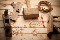 Carpenter tools in pine wood table Stock Photos
